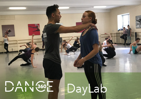 A photo of an instructor working with a dancer at Dance360 DayLab